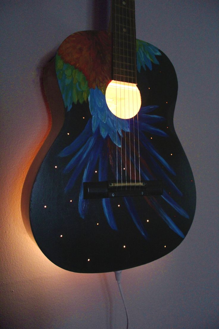 A wall lamp I made from a guitar