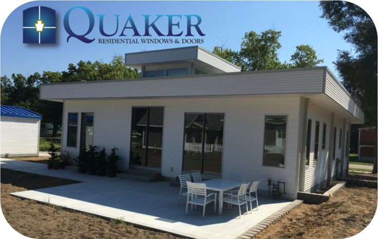 Quaker Residential Project in Douglas, Michigan. A very nice little cottage using Quaker's H600 Series aluminum windows with metallic grey color.