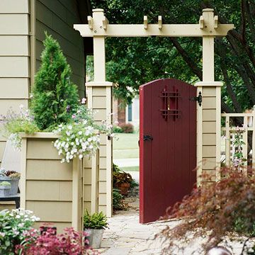 A red arts  crafts style door. A classic, simple and stunning way to enter the garden while creating privacy.