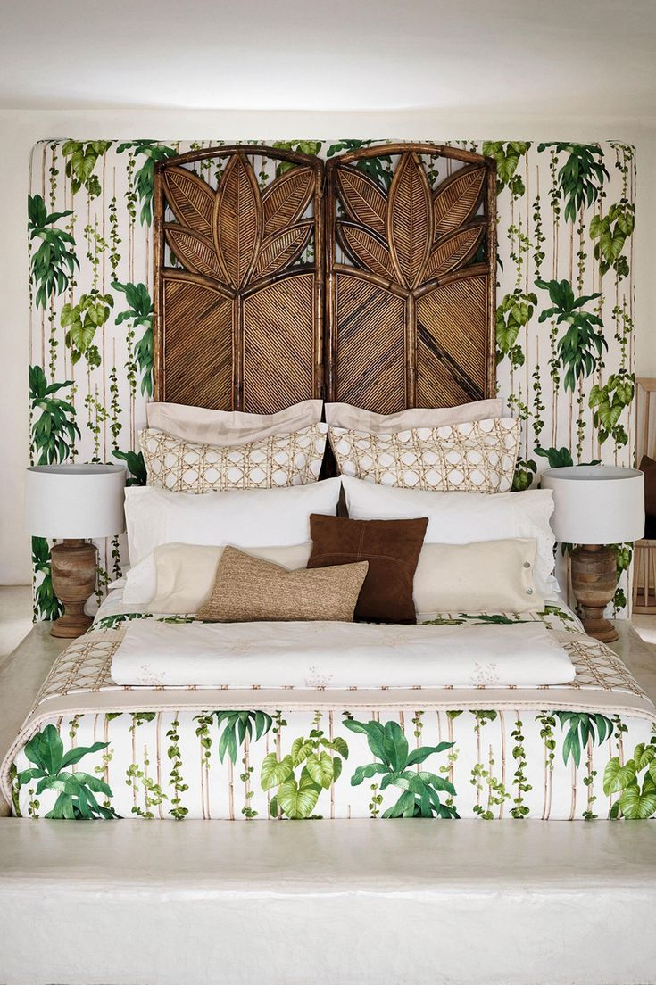 Tropical, palmthemed bedroom with matching bedding