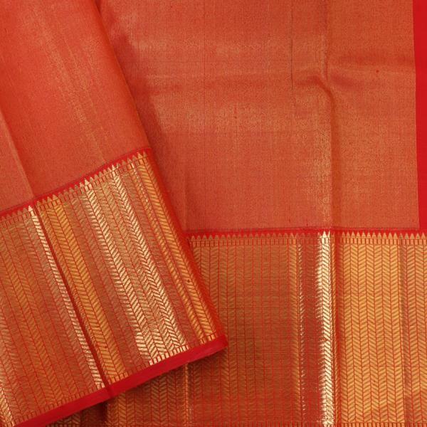 This regal kanjivaram sari in scarlet red is handwoven with gold zari checks. The border is woven elegantly in geometric pattern in gold zari.