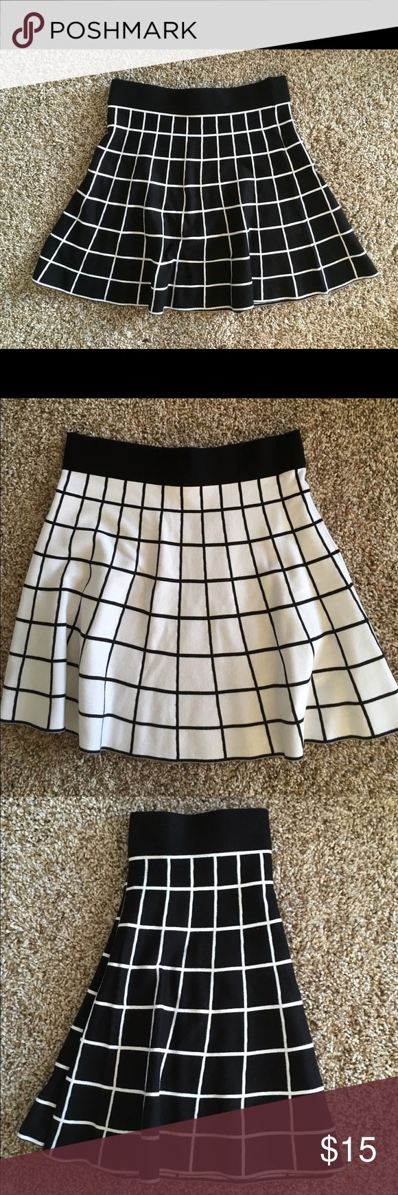 Black and White Skirt - Reversible! Forever 21 Contemporary Line - black and white design skirt w slight pleats for a cute flare. ~ knee length on me, and I am 5' tall. Just discovered this skirt is reversible if you cut the tag out correctly; I never know so left it intact. White side would have exposed black seam, but you can definitely wear it either way with a few thread snips. Size Small; true to size. Great for work or play! Feel free to make an offer! Forever 21 Skirts