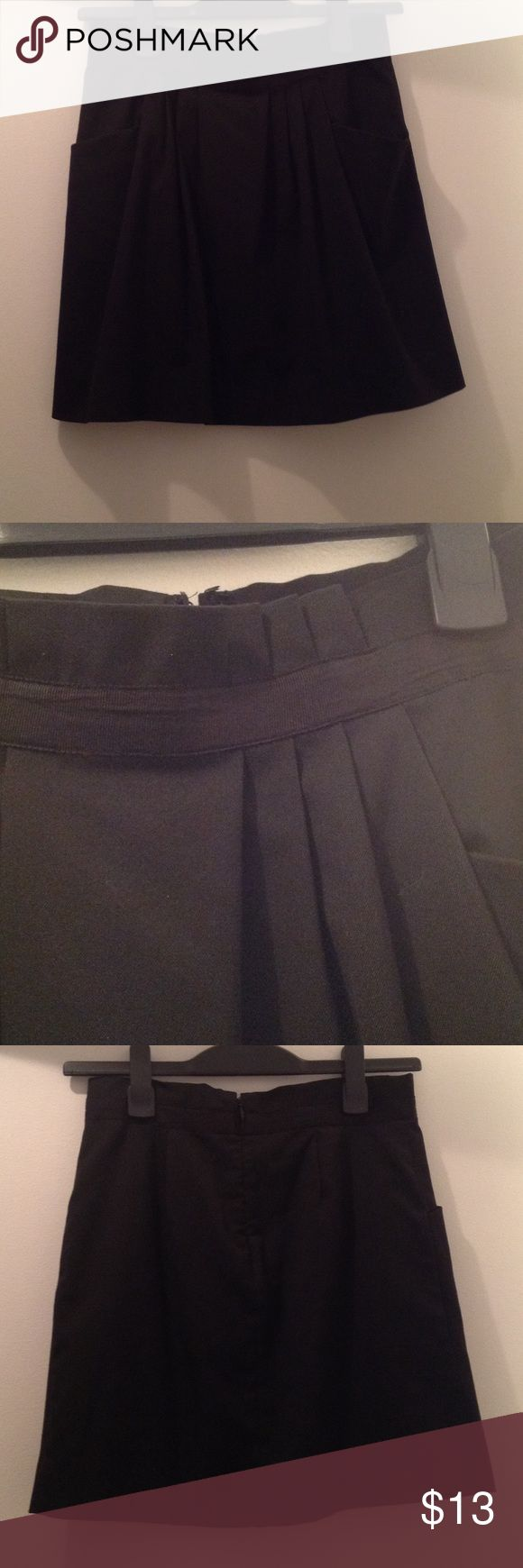 Gap skirt Fully lined black skirt with two front pockets. Zips up in the back. A few pleats in the front GAP Skirts
