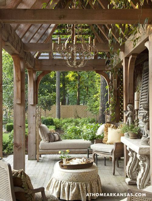 This is a beautiful outdoor space. I love the furniture and chandelier!