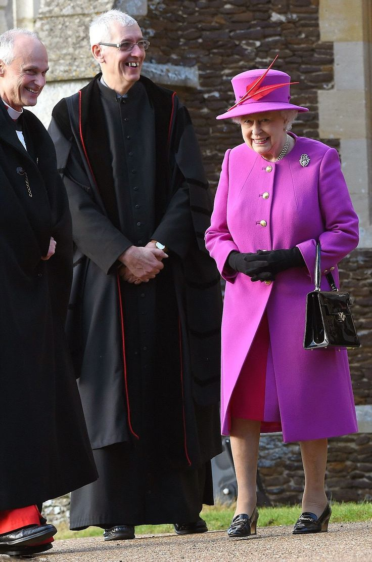 After wrapping up in a brown fur coat this morning, the Queen stepped out in a festive fuchsia coat over a raspberry dress