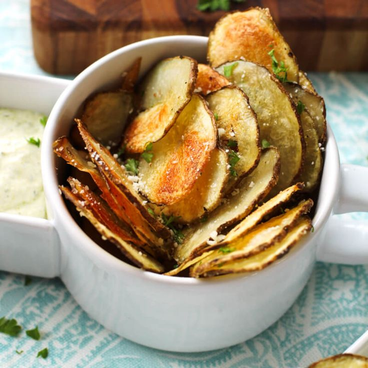 Oven Baked Potato Chips are crisp and satisfying without the frying.  They can be served as an appetizer, snack, or side dish!