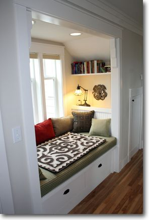 I love the ideas of a window seat reading nook.  It's very cool and I wish I had one now