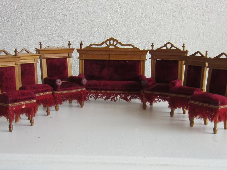 Sofa, two armchairs and four normal chairs all upholstered in red velvet, by Schneegass
