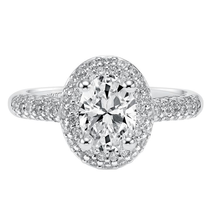 Oval cut diamond engagement ring with multi-row diamond pave shank and halo by ArtCarved Bridal.