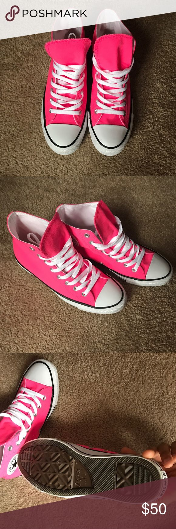 Neon pink high top converse Men's 7, women's 9. I usually wear a 9-9.5 in shoes and these fit perfect. They have never been worn and are in 10/10 condition. Will come with original box when shipped! Converse Shoes Athletic Shoes