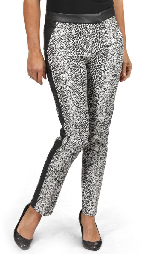 Animal print, stretch jacquard tuxedo pant with faux leather trim. This black and white animal print bottom matches perfectly with our classic boyfriend blazer. Find both styles at a store near you, and online at shop.cartise.com (in Canada only). #Tuxedopant #animalprint #jacquard #cartise