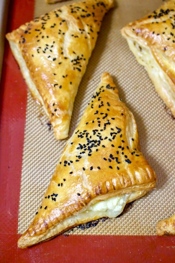 Savory Feta and Black Caraway Pastries are a great appetizer or snack to have around. Very easy to make, these pastries will win your heart in no time! The mild saltiness of the cheese and the aromatic with a peppery bite black caraway seeds make these pastries delicious.