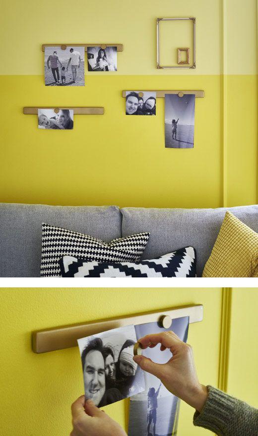 Photos fixées sur des rails magnétiques peints en doré.