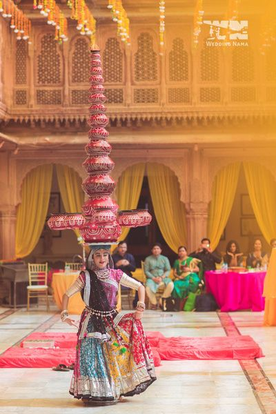 rajasthani dancer , tiered matkas on the head