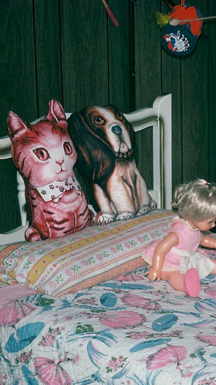 Wow. Talk about a blast from the past...My sister had the kitty. Her very favorite stuffed animal she had on her bed, and my brother had the dog.