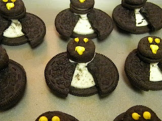 Penguins made from regular and snack size oreos and a little frosting!
