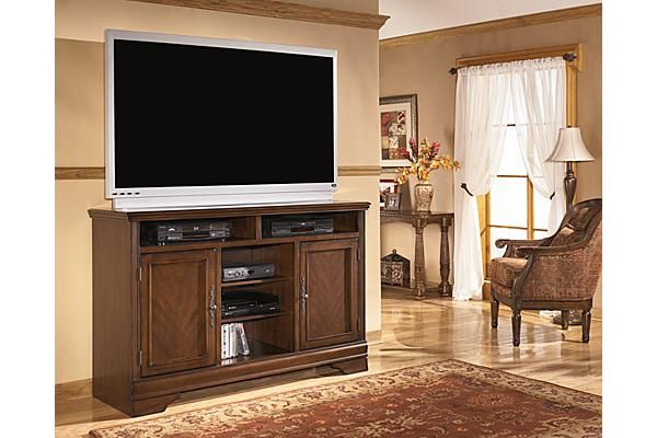 """The Hamlyn TV Stand from Ashley Furniture HomeStore (AFHS.com). With rich traditional style infused with a European flair, the sophisticated elegance of the """"Hamlyn"""" entertainment center is sure to enhance the beauty of any living environment."""