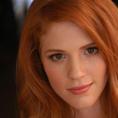 Lydia: red hair + brown eyes.