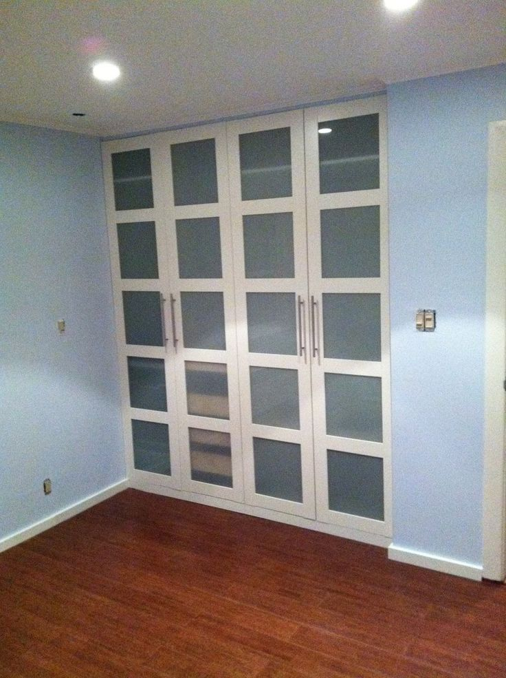 """Materials: Pax wardrobes (1 large, 2 medium and 1 small), Various komplement peices and pax bergsbo / frosted glass doors, Martha Stewart living Paint #MSLO29 """"glass of milk"""", poplar moldings 1×2 and 1×3. Crown molding 1x 5/16. Plaster, paint, Hammer, Screwgun, Level, Screw DriverDescription: I converted a basic reach in closet in a small bedroom …"""