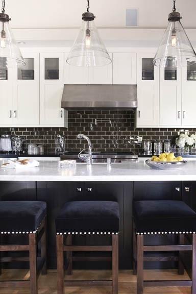 crisp rich masculine colors kitchen design black velvet nailhead backless barstools glass pennant lights white cabinets wall cabinets dual  panel wall cabinet design dark subway tile backsplash