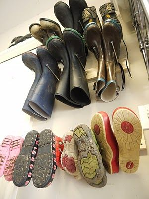 diy boot rack for garage shoe organization- even cuter with dowels instead of nails!