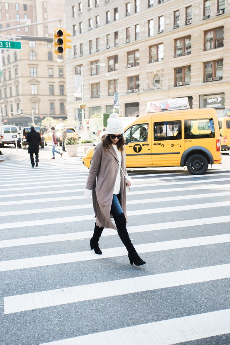 Krystal Bick exudes cool and casual vibes in this classy thigh high boots outfit which consists of denim jeans, a cream sweater, and a beige overcoat with a cross body handbag. Coat: MM. LaFleur, Sweater: Abercrombie & Fitch, Jeans: DL 1961, Boots: Stuart Weitzman, Bag: Strathberry.