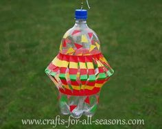 pop bottle wind spinner..complete instructions to make!! These can really spin fast!!..I like hanging these in my cherry tree.. It keeps the birds away!!