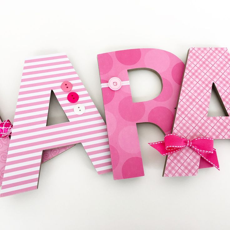 Pink letter set with button and bow embellishments