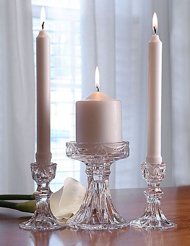 I love this Waterford clear glass candle holder for the unity candle but any clear glass ones will do fine. Marquis by Waterford                                              Unity Candle Set- Go with these type of candles in ivory color with these glass candle holders. I like these really well though. Could put a pearl bead band around middle unity candle holder stem for more of a vintage look.