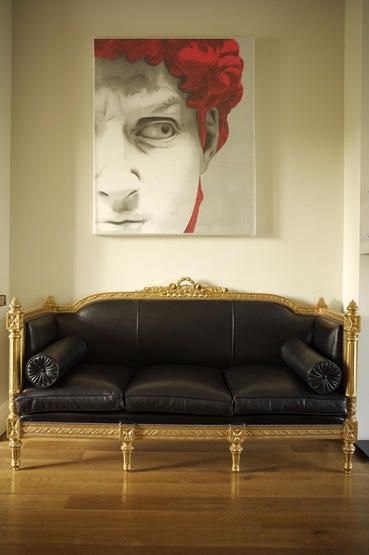 white living room black leather french louis xvi style sofa painting picture artwork art paul ross coffey wooden flooring real home