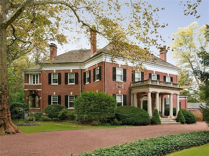 thefoodogatemyhomework:  Brick Georgian revival style home by John Russell Pope in Princeton, New Jersey, c1900. Love the hefty weight of the structure, the asymmetry, the thick white cornice, the keystones above every black shutter clad window, the stone flower swags, and that big ol' portico.