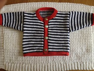 A lovely cardigan for a baby or toddler with a nautical vibe … Made from dk yarn in denim and cream in narrow stripes with red borders … This unisex style can be made in other colours if preferred … You'll also need 4 buttons to fasten the cardigan … Spotty, plain or matching the choice is yours …