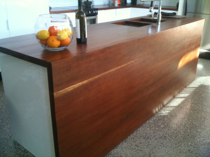 This spotted gum kitchen work-tops and these 3 x 3metre slabs and numerous off-cuts of 1.2metre down to 500mm are the left-overs. The timber is R45 + and is able to take the edge off most saws and drills, as for sanding/finishing - hard work but wonderful when finished. So 3 x 3metre lengths, 1 x 1.2metre and a few around 500mm Any bid is to buy the lot - not per metre Added a picture today of the finished kitchen bench so you can see finished colour of timber with a matt sealer.