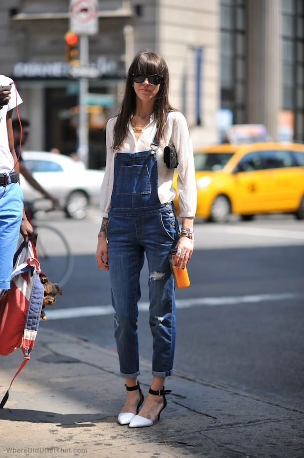 Street Style: Overalls + Pumps Grown Up Chic Dungarees Heels Distressed Denim Overalls Cat Eye Sunglasses Whithe Button Up Blouse Shirt Clutch Bag Layered Stacked Bracelets Two Tone Heels White Black Ankle Strap Pumps