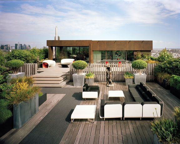Topiary In Concrete Planters On Roof Terrace