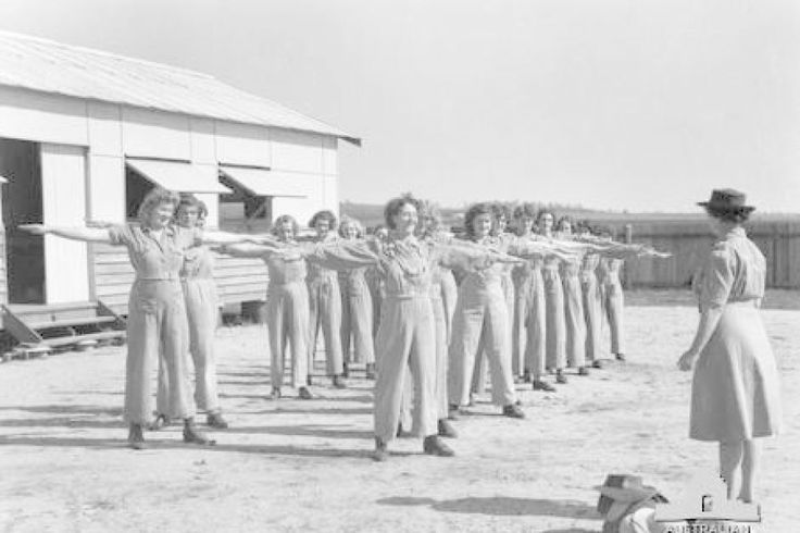 Members of the Australian Women's Land Army are put through a training drill in Atherton in north Queensland during World War II ~