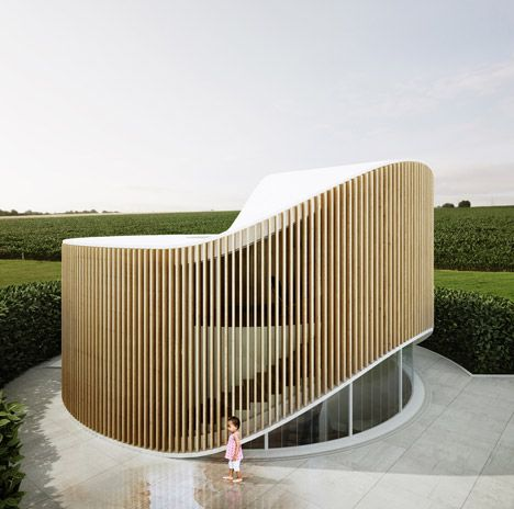 House based on the form of a tree stump.