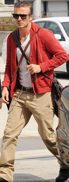 Good way to wear colour. Red woollen cardigan. Neutral trousers. White t-shirt. Belt chain. Accessories. David Beckham.