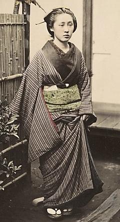 Woman. Hand-colored photo, 1870's, Japan, by photographer Shinichi Suzuki.