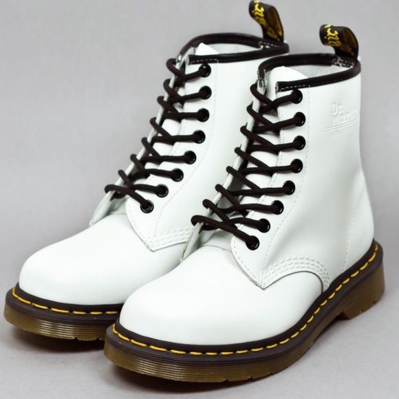 White Doc Martins Worn twice with a little bit of marks but can be cleaned very easily but other than that great condition. Willing to negotiate Doc Martins Shoes Combat & Moto Boots