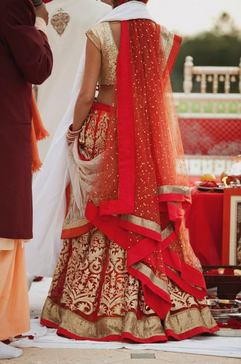 red and gold bridal lehenga. Love the dupatta