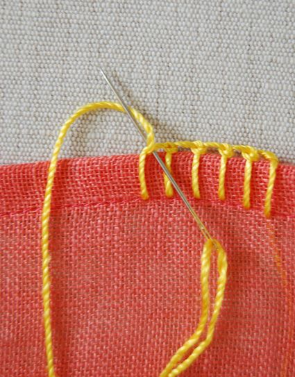 knotted buttonhole blanket stitch - 'Place your needle underneath the top of the blanket stitch you just created and on top of the working thread in the same manner as for the blanket stitch- the difference being that you are now creating a little knot instead of a stitch.' - the purl bee