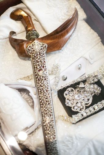 Groom's wedding suit accessories | A Glamorous Javanese Wedding With Military Traditions | http://www.bridestory.com/blog/a-glamorous-javanese-wedding-with-military-traditions