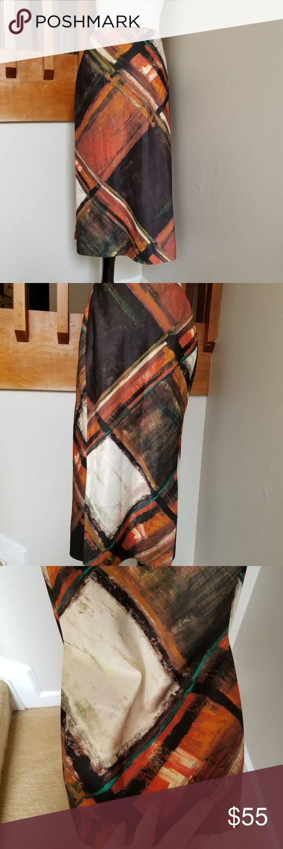 "Lafayette 148 Midi Skirt - size 14 Funky fully lined midi skirt by Lafayette 148. Great condition with two double slits in the back...awesome with a pair of boots or a pair of heels.  Waist 18"" Waist to Hem - 30.5"" Hips 22.5"" Double slits 10""  Non-smoking environment.  Welcoming offers and questions!! Lafayette 148 New York Skirts Midi"