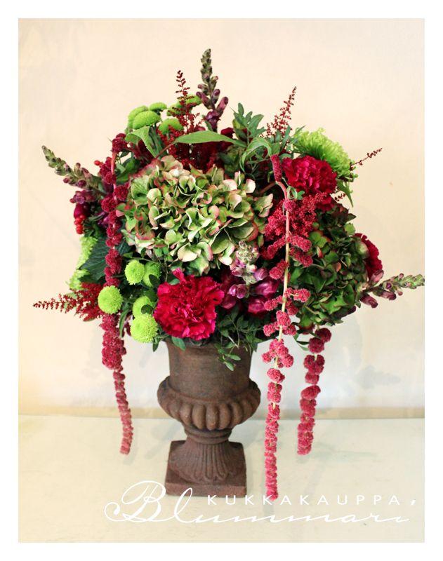 green and winered flower arrangement