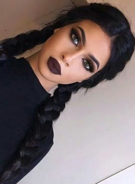 Wednesday, Addams Family:  dark makeup, eye, lip color