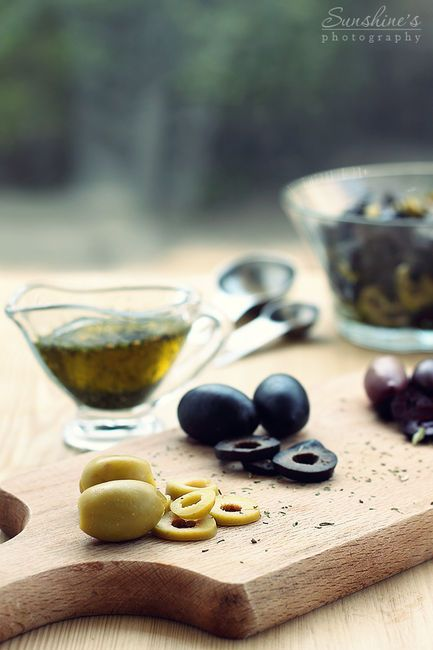 Green, black olives and olive oil.