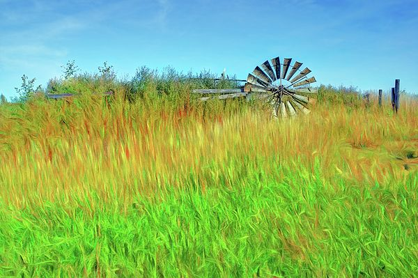 """Lying Down on the Job"" by Nikolyn McDonald Photography adds a painted look to a photo of an old, abandoned windmill in a field.  Brightly colored layers of grass and sky give the picture a festive look. hill,country,rural,wind,kansas,farm,energy,vintage,american,usa,summer,agriculture,water,blades,horizontal,mechanical,machine,power,prairie,farming,traditional,mill,wind-pump,rotational,vanes,sails,midwest,midwestern,rooks,graham,county,nikki"