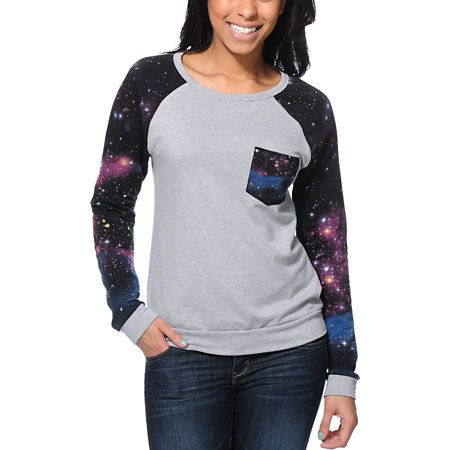 Add some intergalactic style to your wardrobe with the Lira Galactic pocket crew neck sweatshirt for girls. Designed with a Heather Grey body and contrasting Black galaxy print raglan sleeves and chest pocket, this pullover crew neck sweatshirt from Lira will keep you in infinite style.