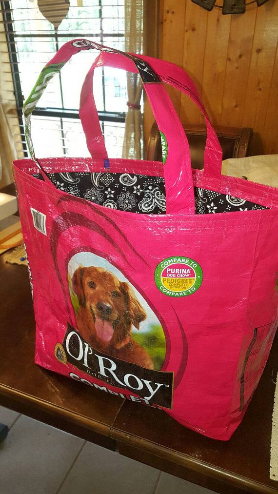 This is a recycled red ol Roy dog food plastic feed sack turned into a nice sized bag/purse/tote or a reusable shopping bag. It has a nice black paisly bandana fabric liner added to it. These are hand sewn strong and durable